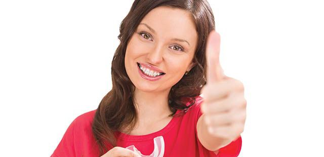 Smiling woman with orthodontics