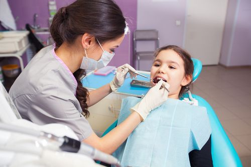 young girl with a dentist